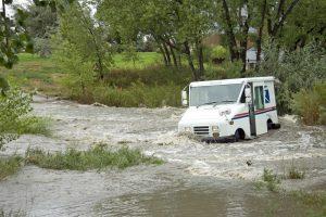 USPS truck in flood
